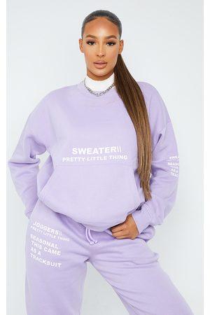 PRETTYLITTLETHING Oversized Slogan Print Pocket Front Sweater
