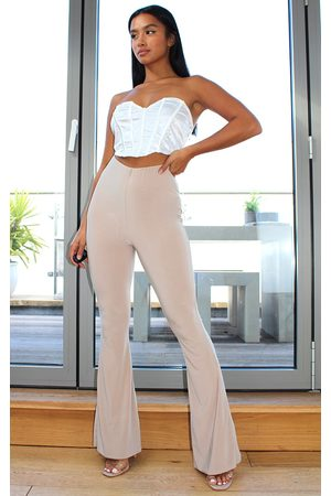 PRETTYLITTLETHING Petite Stone Flare Ruched Bum Slinky Pants