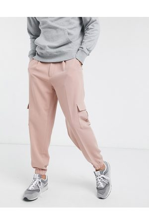 ASOS Cargo Pants - Oversized tapered smart sweatpants in with cargo pocket