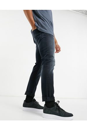 Jack & Jones Intelligence Glenn super stretch slim tapered jeans in black