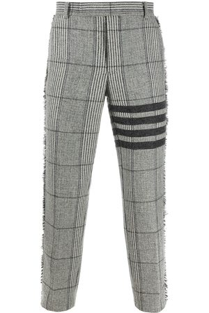 Thom Browne 4-Bar Prince of Whales check frayed chinos - 055 LIGHT GREY