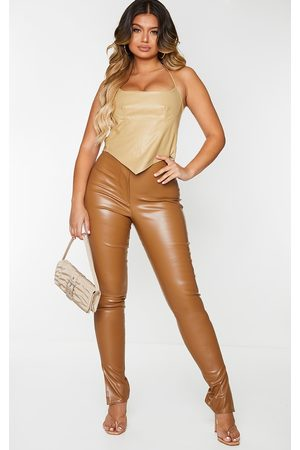 PRETTYLITTLETHING Tan Faux Leather Split Hem Skinny Trousers