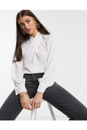 ASOS Long sleeve top with twist neck detail in ivory