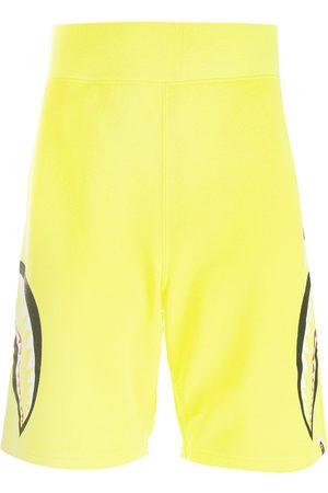 A BATHING APE® Shark print track shorts