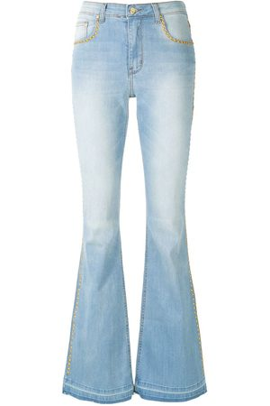AMAPÔ Flared denim trousers with studs