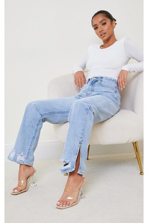 PRETTYLITTLETHING Petite Light Wash Distressed Split Hem Straight Leg Jeans