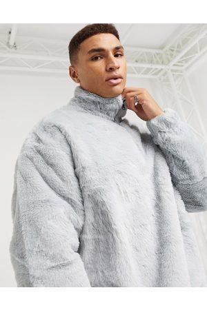 ASOS Oversized faux fur sweatshirt with high neck & half zip in
