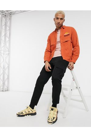 ASOS Twill overshirt in orange with sunset front embroidery