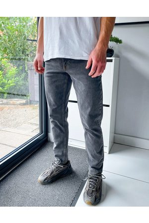 ASOS Tapered jeans in washed