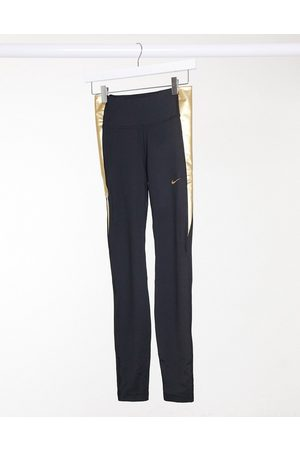 Nike One tight leggings in and gold