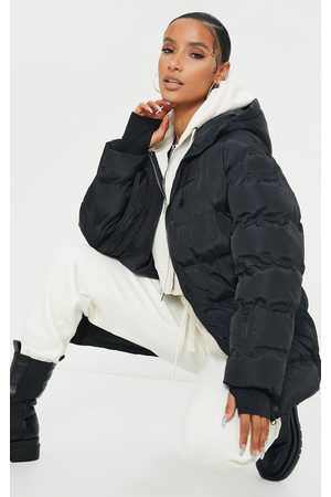 PRETTYLITTLETHING Quilted Belted Cuffed Sleeve Puffer Coat.