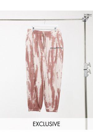 Reclaimed Vintage Inspired sweatpants in tie-dye wash in rust