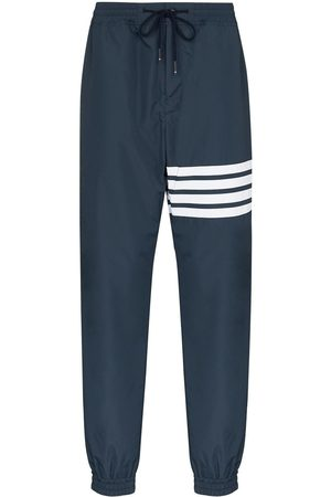 Thom Browne 4 stripe flyweight track trousers - 415 Navy