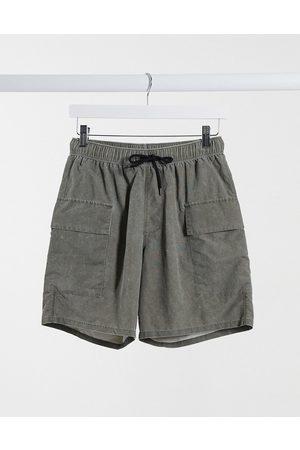 ASOS Swim shorts with cargo pockets in khaki acid wash