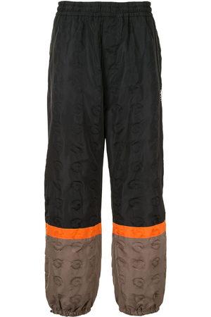 UNDERCOVER Men Sweatpants - Colour-block track pants
