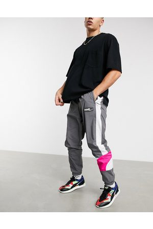 PUMA Sweatpants - Hoops color block track pants in and pink-Grey