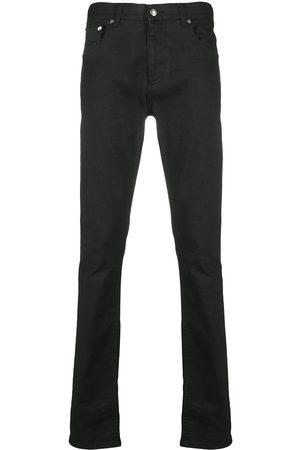 Alexander McQueen Logo-studded slim-fit jeans