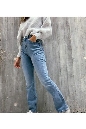 ASOS ASOS DESIGN Petite high rise '70s stretch flare jeans in midwash