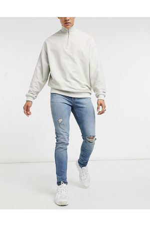 ASOS Skinny jeans in vintage mid wash with knee rip and abrasions