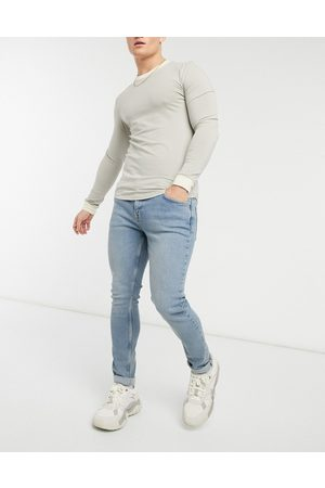 ASOS Skinny jeans in vintage look tinted light wash