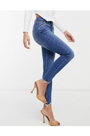 River Island High rise skinny jeans in mid authentic