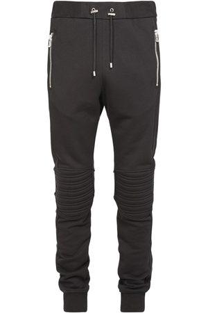 Balmain B Logo Embossed Cotton Jersey Sweatpants