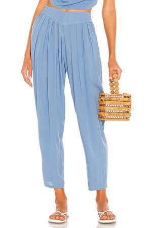 Indah Tanah Solid 80s Pleated Trouser in Blue.