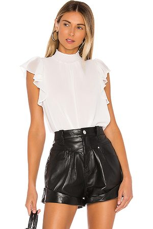 1. STATE Flutter Sleeve Smock Neck Blouse in White.