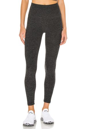 Beyond Yoga Caught In The Midi Legging in Charcoal.