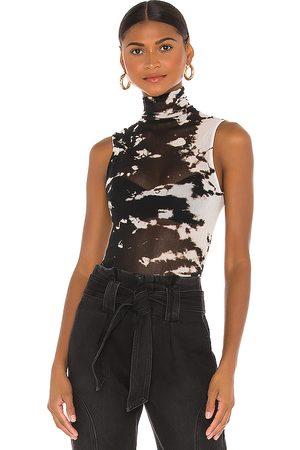 ENZA COSTA Cotton Mesh Sleeveless Turtleneck in Black & White.