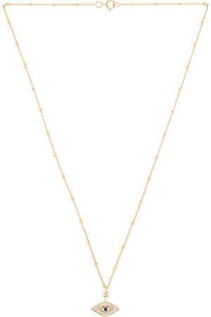 Joy Dravecky Jewelry Midnight Gaze Necklace in Metallic Gold.