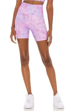 Beach Riot X REVOLVE Bike Short in Purple.