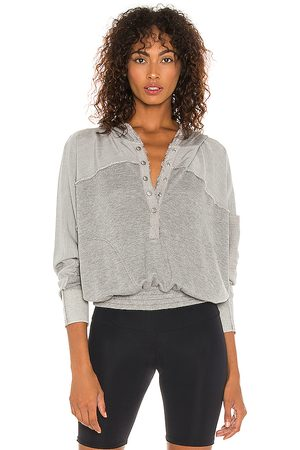 Free People X FP Movement Windy Meadow Hoodie in Light Grey.