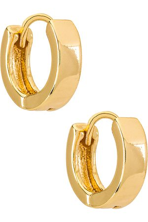 Natalie B Jewelry Marga Huggy Hoop Earring in Metallic .