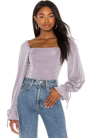 Free People Meant To Be Bodysuit in Lavender.
