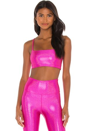 Beach Riot X REVOLVE Izzy Sports Bra in Fuchsia.