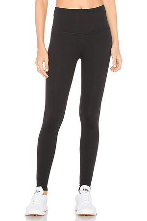 Beyond Yoga High Waisted Midi Legging in Black.