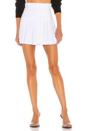 Norma Kamali Pleated Mini Skirt in White.