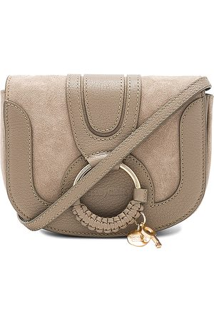 See by Chloé Hana Mini Crossbody Bag in Neutral.