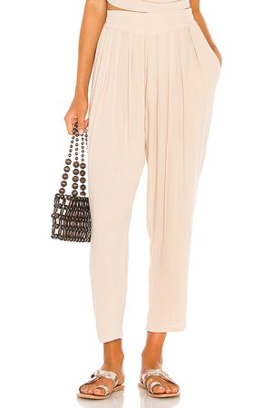 Indah Tanah Solid 80s Pleated Trouser in Beige.