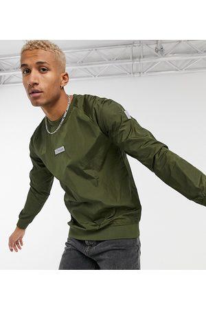Ellesse Crew sweatshirt in hi-shine khaki exclusive to ASOS