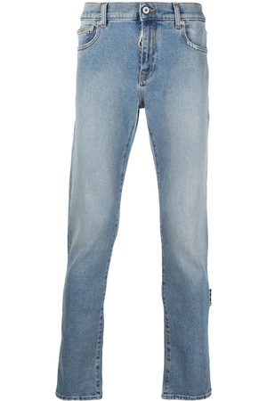 OFF-WHITE Diagonal stripe skinny jeans