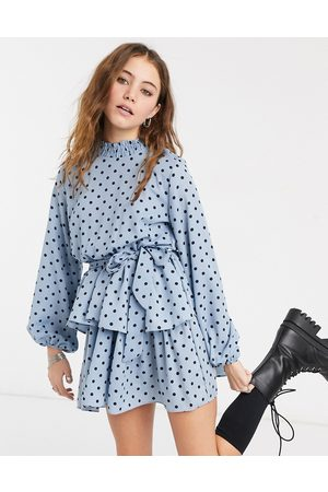 In The Style X Olivia Bowen high neck skater dress with belt in blue polka print-Multi