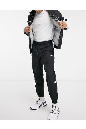 PUMA XTG track pants in