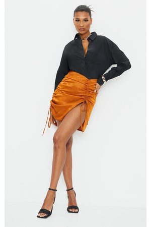 PRETTYLITTLETHING Rust Hammered Satin Ruched Detail Mini Skirt