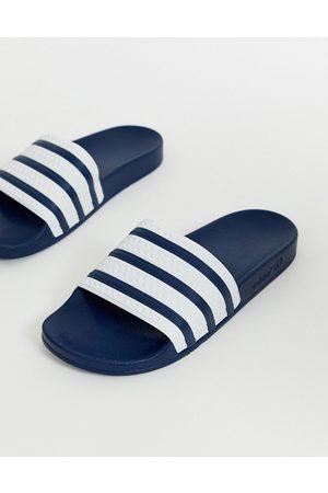 adidas Adilette sliders in navy