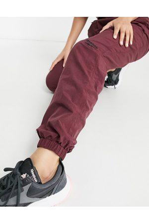 Reebok Logo cuffed sweatpants in burgundy