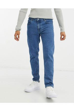 ASOS Stretch tapered jeans in retro mid wash blue-Blues