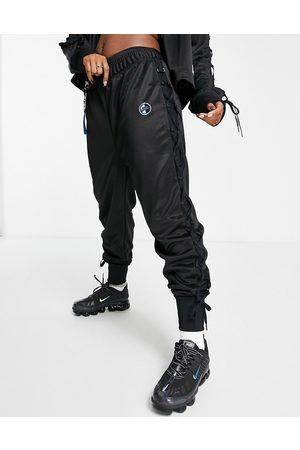 Nike Sisterhood lace-up detail polyknit track pants in