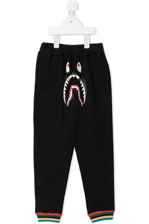 A BATHING APE® Shark-print track pants